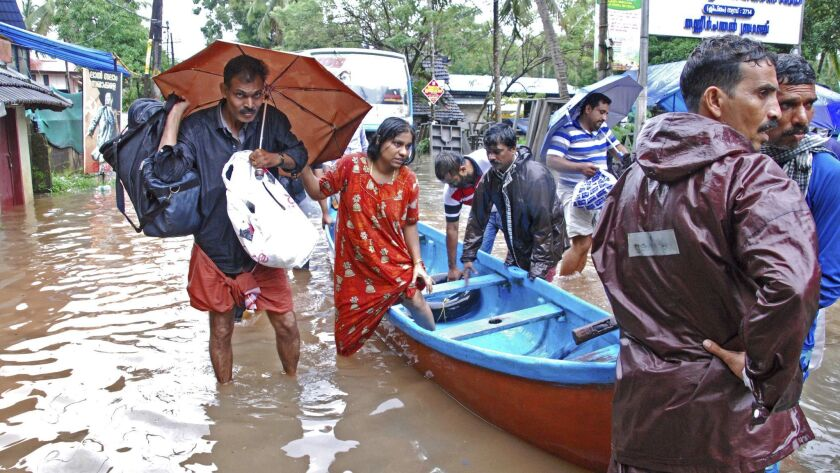 People are evacuated in Kozhikode, in the southern Indian state of Kerala, on Thursday.