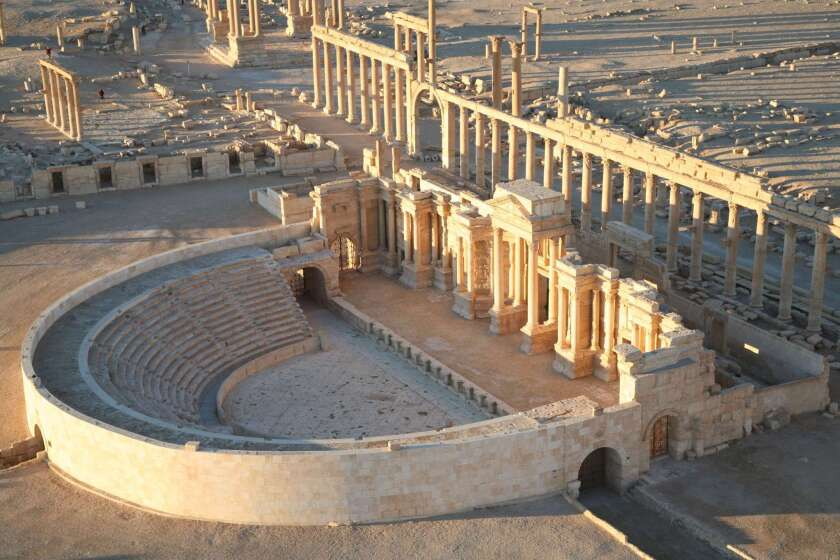 "An aerial view taken in 2009 shows Palmyra's impressive amphitheater. Immediately behind it is the 3,600-foot long colonnade that welcomed visitors to the city. UNESCO warned that the destruction of the ancient city would be ""an enormous loss to humanity."""