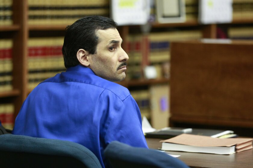 Defendant Ignacio Canela sits in court before Judge Frederic Link during opening statements in his Superior Court trial.