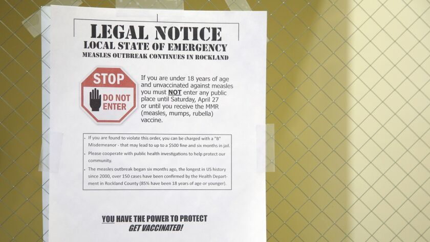 A sign explaining the local state of emergency is displayed at the Rockland County Health Department