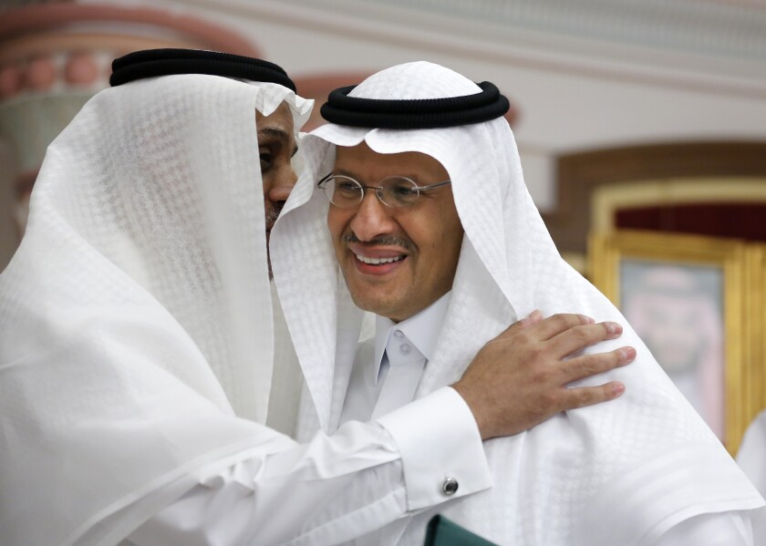 Energy Minister Prince Abdulaziz bin Salman smiles as he is congratulated after a press conference in Jiddah, Saudi Arabia, Tuesday, Sept. 17, 2019. Saudi Arabia's energy minister said Tuesday that 50% of its daily crude oil production that was knocked out by a weekend attack had been restored and that full production is expected by the end of the month.(AP Photo/Amr Nabil)