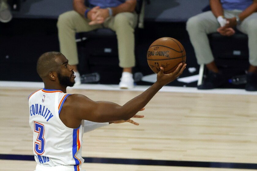 Oklahoma City Thunder point guard Chris Paul drives for a layup against the Lakers.