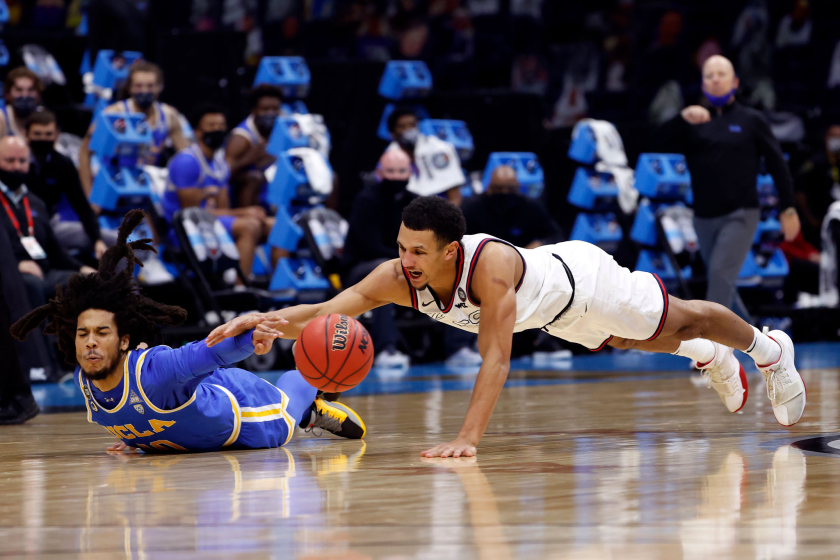 UCLA's Tyger Campbell, left, and Gonzaga's Jalen Suggs fight for a loose ball in the NCAA Final Four in April.