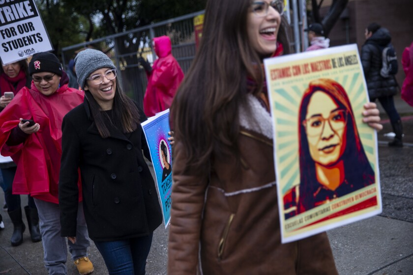 LOS ANGELES, CALIF. - JANUARY 16: Roxana Duenas, center, whose face appears on the widely circulated