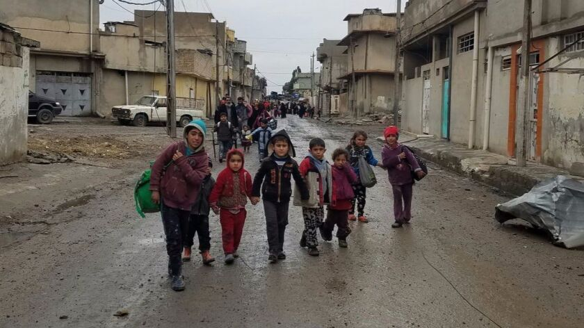 Children are among those fleeing fighting between Iraqi forces and Islamic State in Mosul.