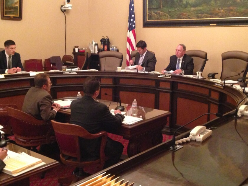 Sen. Richard Roth (D-Riverside), right, questions Jim Lombard (gray suit) and Tony Davidson, two top officials from the state controller's office, about a failed effort to upgrade the state payroll system on Thursday.