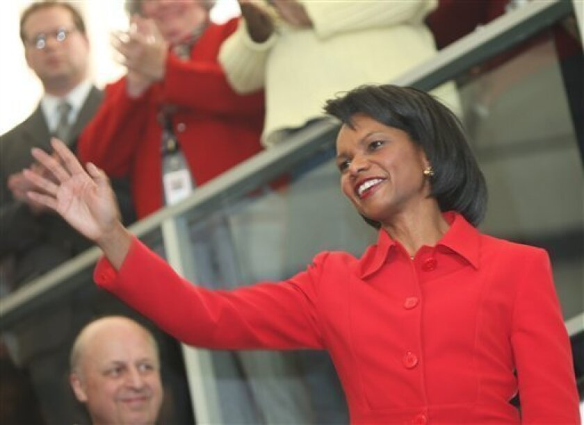 Secretary of State Condoleezza Rice waves while delivering a farewell speech, Friday, Jan. 16, 2009, at the State Department in Washington. (AP Photo/Haraz N. Ghanbari)