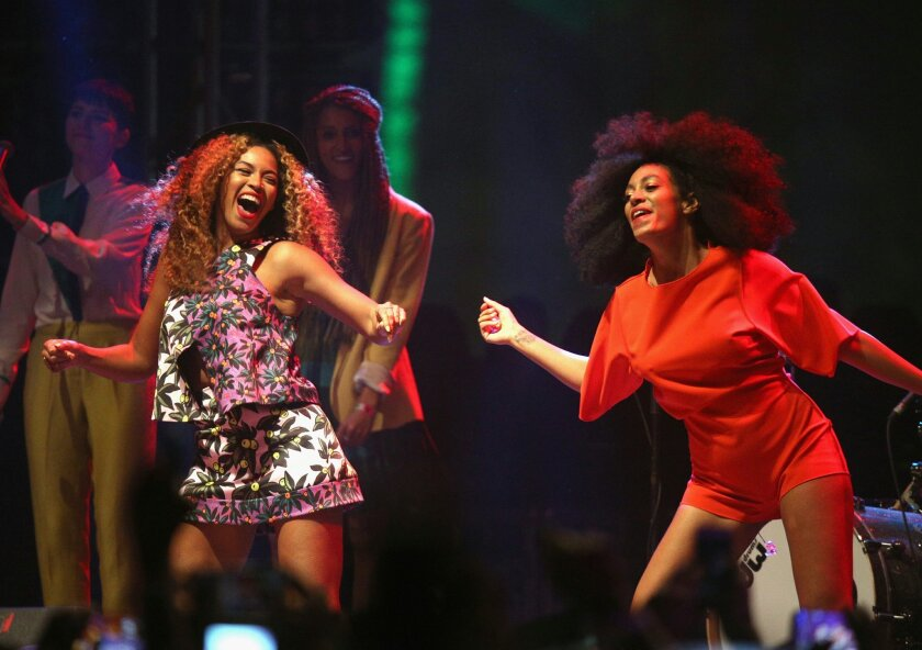 Singers Beyonce (L) and Solange perform onstage during day 2 of the 2014 Coachella Valley Music & Arts Festival at the Empire Polo Club on April 12, 2014 in Indio, California.