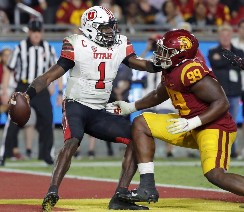 USC defensive lineman Drake Jackson closes in for a sack and safety of Utah quarterback Tyler Huntley in the fourth quarter at the Coliseum on Friday.