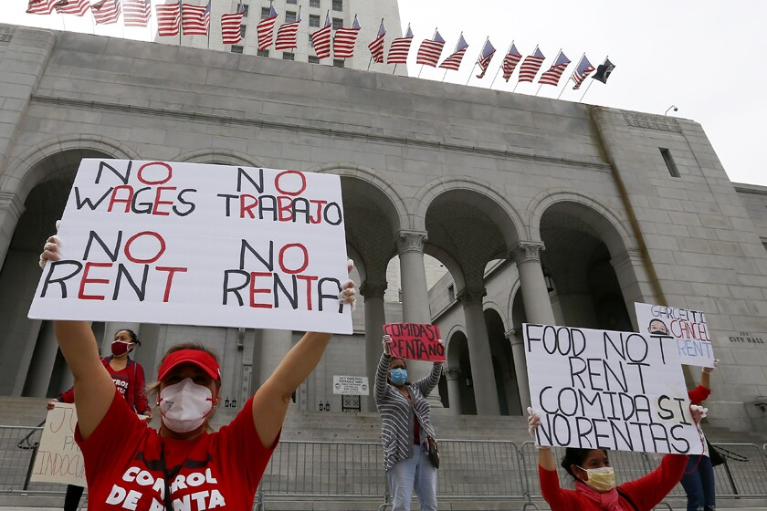 Tenants asking for rent relief and their supporters gather at city hall in Los Angeles on April 20.