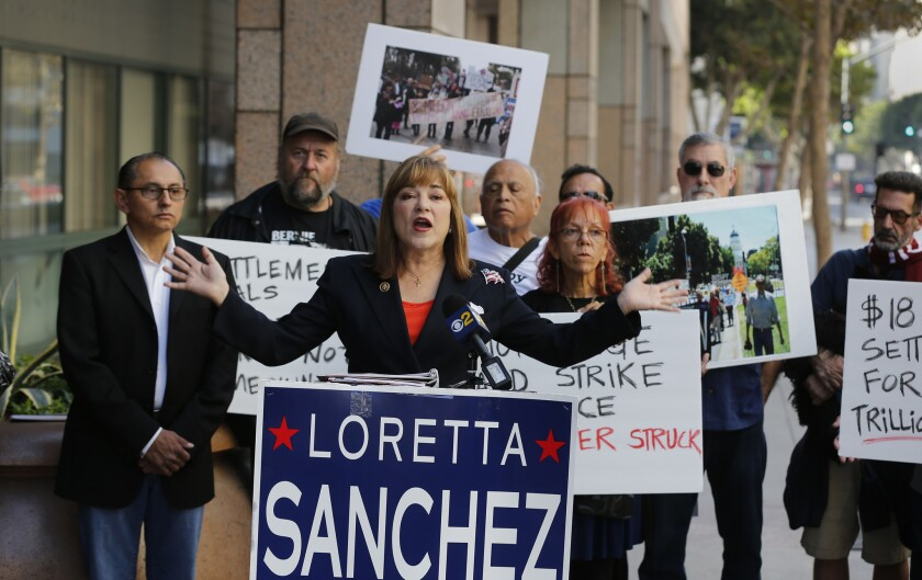 Senate candidate Loretta Sanchez speaks at a news conference to criticize the 2012 mortgage settlement made by Atty. Gen. Kamala Harris outside the Ronald Reagan State Building in Los Angeles on Oct. 26, 2016.