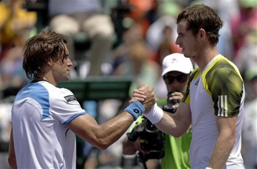Andy Murray of Britain, right, shakes hands with David Ferrer of Spain after their final match of the Sony Open tennis tournament Sunday, March 31, 2013, in Key Biscayne, Fla. Murray won 2-6, 6-4, 7-6 (1). (AP Photo/Wilfredo Lee)