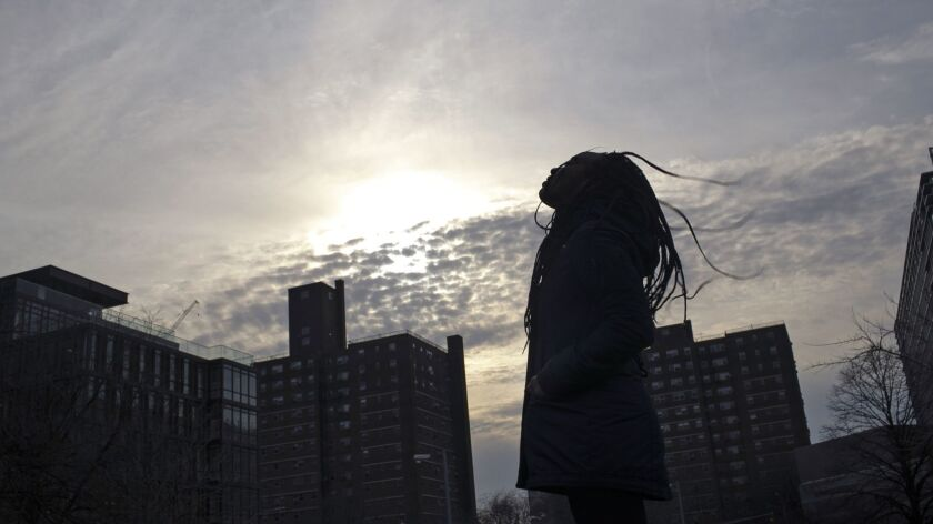 A survivor of sexual assault meditates in the Brooklyn borough of New York on Thursday, March 14, 20
