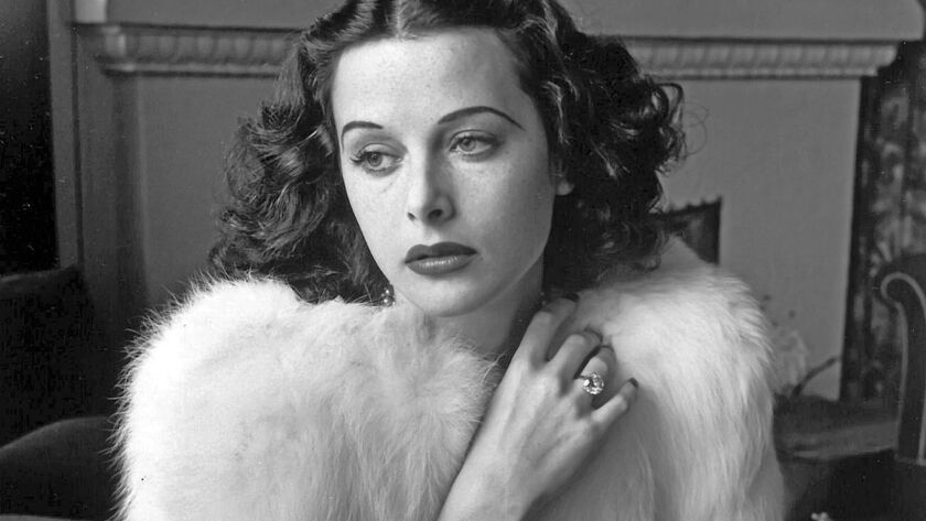 Hedy Lamarr - Glamorous portrait of movie actress Hedy Lamarr wearing white fox fur short jacket.193