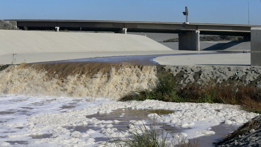 CORONA, CALIF. -- FRIDAY, JANUARY 8, 2016: Storm water flows down the Santa Ana River channel from