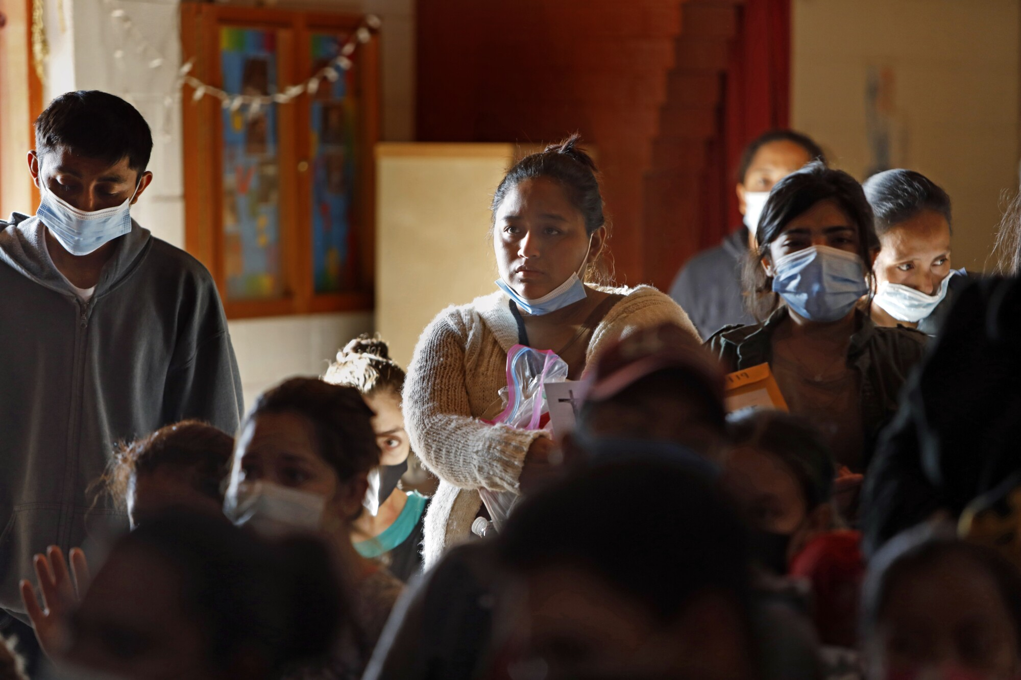 Migrants from Honduras and Guatemala are temporarily staying at a shelter in Mission, Texas.