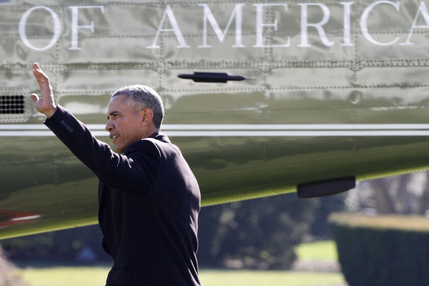 President Barack Obama waves before boarding Marine One helicopter on the South Lawn of the White House on Jan. 13.