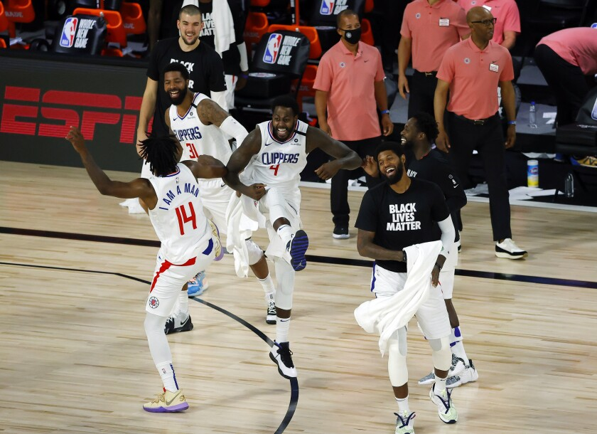 Clippers players celebrate after breaking a team three-point record against the Pelicans on Aug. 1, 2020.
