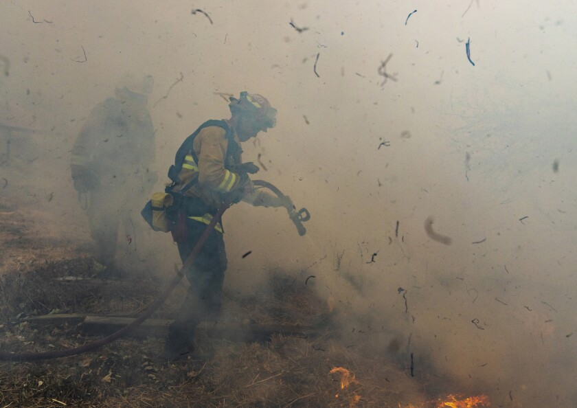 Firefighters from San Mateo battle the Kincade fire Oct. 27 in Sonoma County.