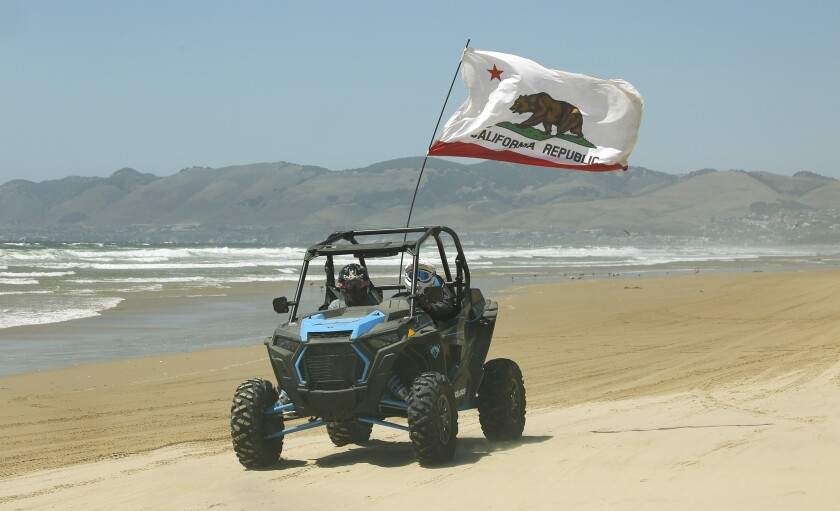 OCEANO, CA - JULY 03, 2019 - driving on the sand at The Oceano Dunes State Park, a few miles south o