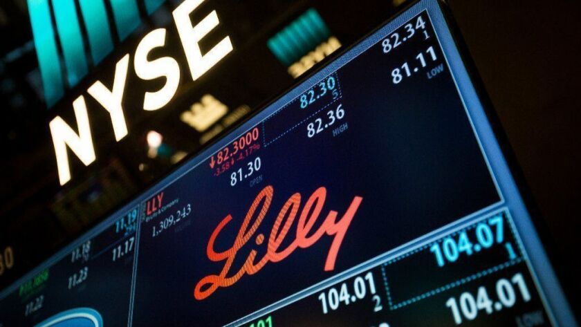 The Eli Lilly and Co. logo is seen April 17, 2017 on a monitor on the floor of the New York Stock Exchange. The company is spending about $8 billion to buy Loxo Oncology.