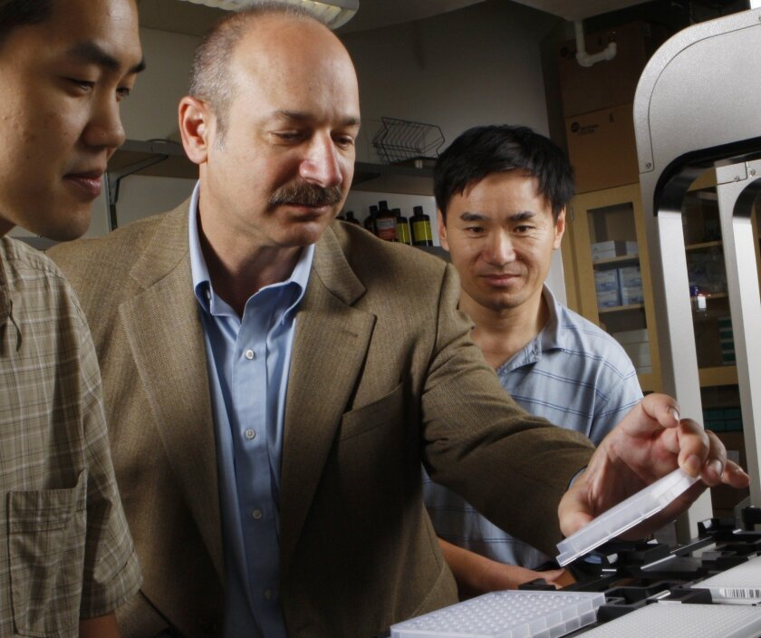 Kevin Khovananth, Scientific Associate, Bruce Beutler, M.D., Professor and Chairman, and Yu Xia, Ph.D., Staff Scientist.