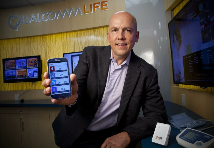 Rick Valencia shows off Qualcomm's 2net Mobile application for Android smart phones. Last month, Qualcomm entered into an agreement with drug giant Novartis to bring connectivity to the an inhaler.