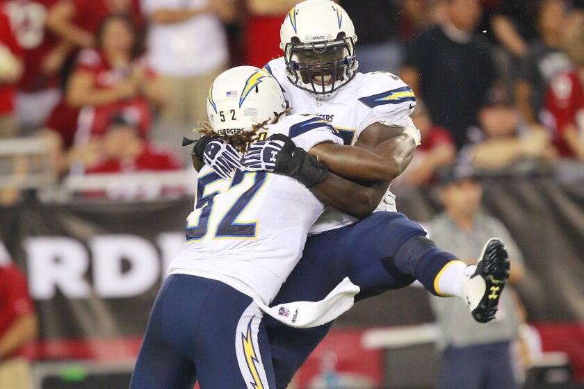 Chargers Jerry Attaochu celebrates a blocked punt quarter against the Cardinals.