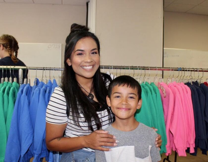 """Nereida and Armando Jimenez were among recipients of the recent """"Assistance League Operation School Bell Clothing Children at Camp Pendleton,"""" sponsored by seven AL chapters."""