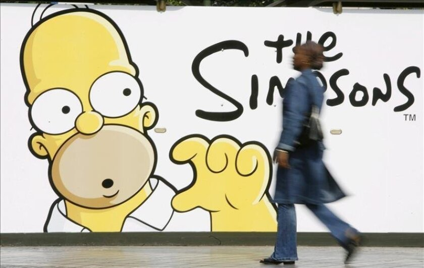 """A woman walks past a poster of the film The Simpsons. Nearly 25 years after the iconic American TV show """"The Simpsons"""" aired for the first time, the animated cartoon that has become a staple of global pop culture still hasn't lost its famous and sarcastic sense of humor. EFE / File"""