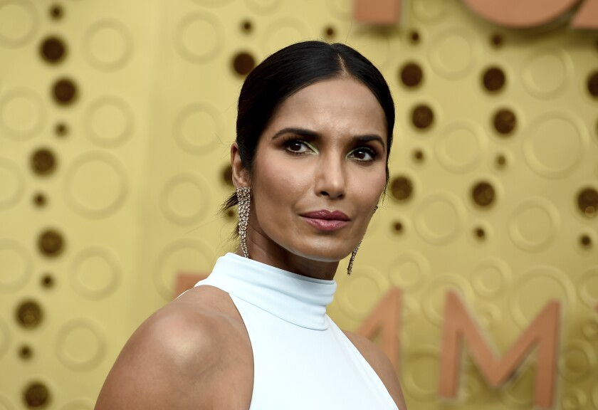"""FILE - In this Sept. 22, 2019 file photo, Padma Lakshmi arrives at the 71st Primetime Emmy Awards in Los Angeles. The """"Top Chef"""" host and best-selling author is working on her first picture book, """"Tomatoes for Neela."""" Viking Children's Books announced Tuesday that the book is scheduled for fall 2021. (Photo by Jordan Strauss/Invision/AP, File)"""