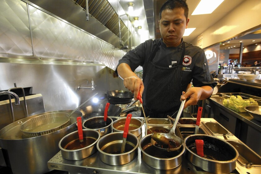 Panda Express made its reputation on orange chicken — its bestselling item — and the fresh-cut ingredients in the Rosemead chain's Chinese stir-fry. Above, the Panda Express Innovation Kitchen in Pasadena.