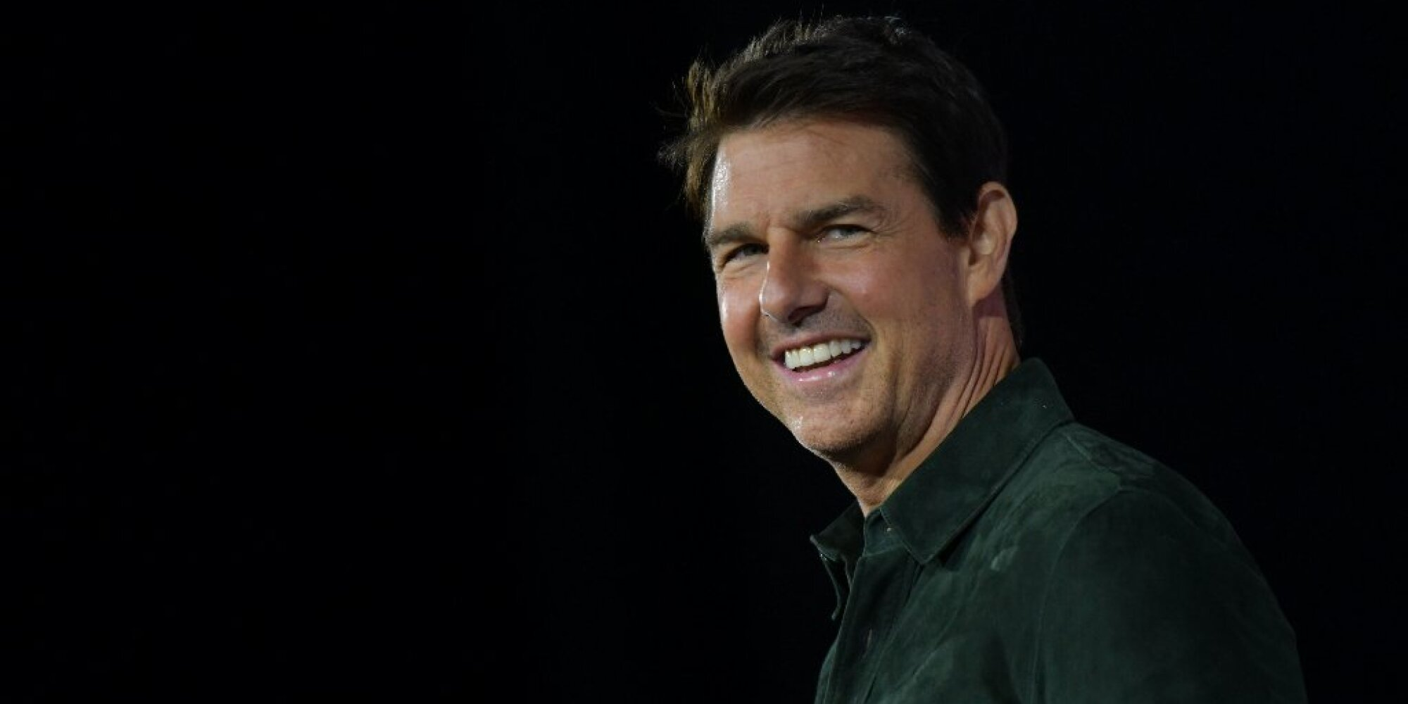 Actor Tom Cruise makes a surprise appearance in Hall H to promote Top Gun: Maverick at the Convention Center during Comic Con in San Diego, California on July 18, 2019.