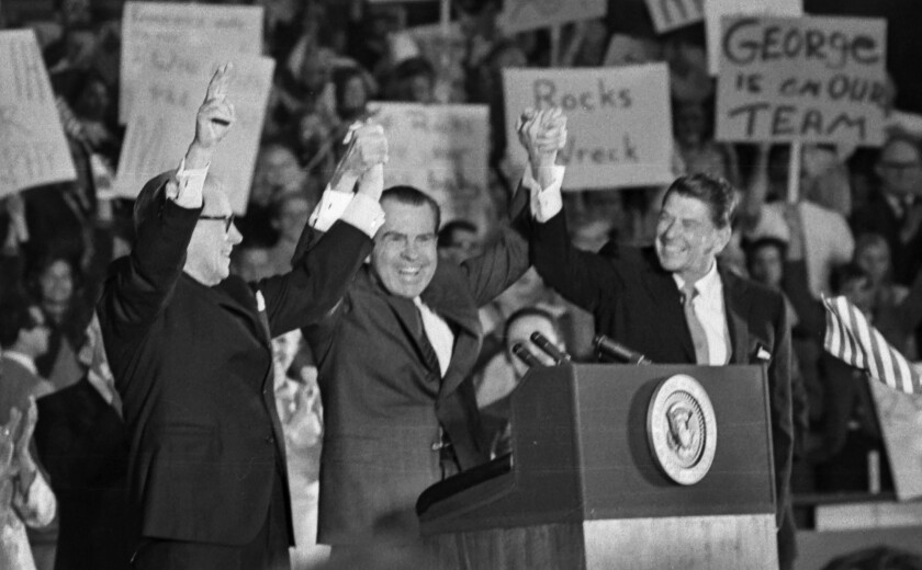 Oct. 30, 1970: President Nixon clasps hands with Gov. Ronald Reagan and Sen. George Murphy at Republican rally in Anaheim.