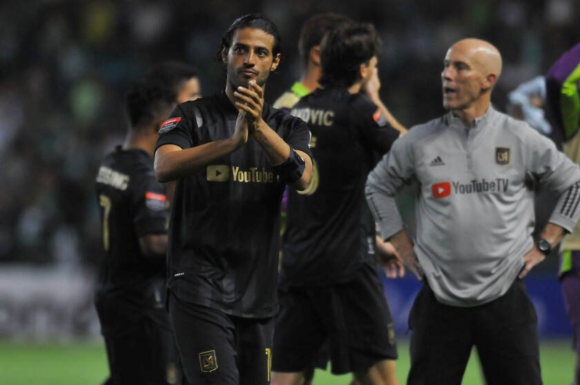 Carlos Vela claps his hands during an LAFC game.