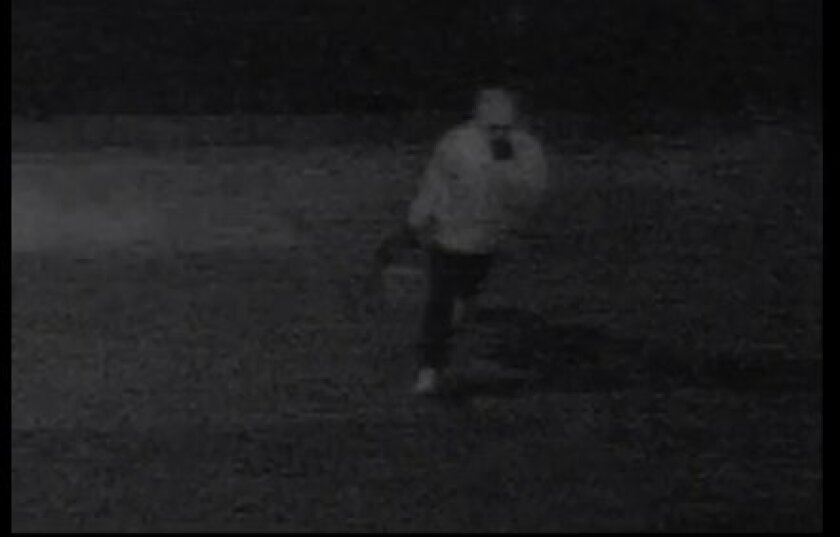 This screen grab from surveillance video shows one of the men involved in a home invasion robbery in Sorrento Valley on Jan. 31.