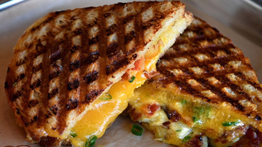 The loaded potato grilled cheese has smashed fingerling potatoes with cheddar cheese, sour cream, sc