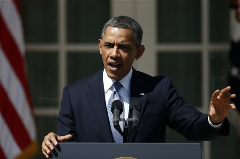 President Barack Obama gestures as he speaks about his proposed fiscal 2014 federal budget, Wednesday, April 10, 2013, in the Rose Garden of the White House in Washington. (AP Photo/Charles Dharapak)