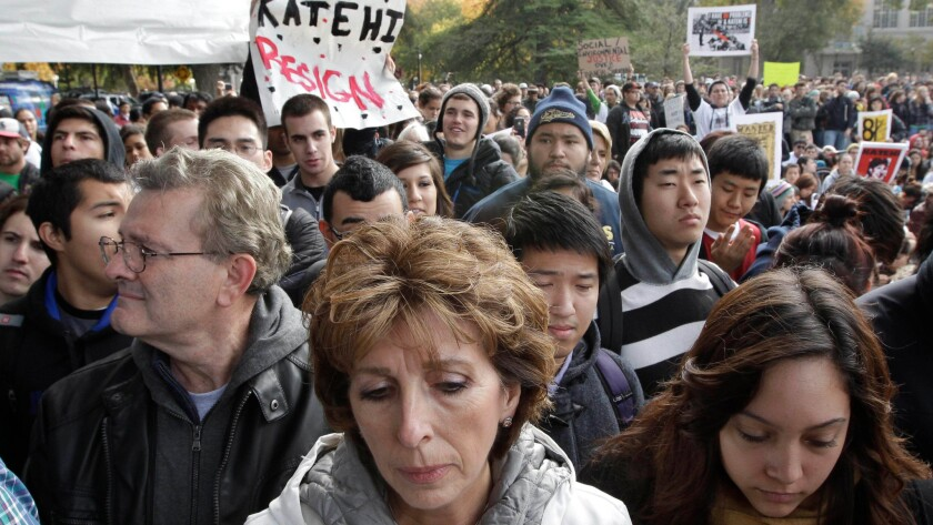 UC Davis Chancellor Linda Katehi (in white coat) attends a campus rally in November 2011, days after a campus police officer pepper-sprayed student protesters.