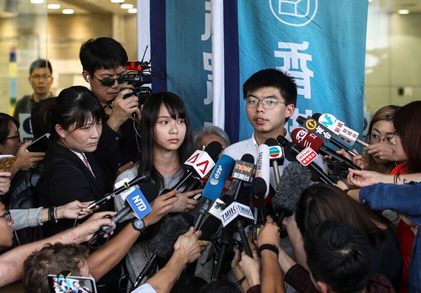 Demosisto leaders Joshua Wong (C-R) and Demosisto member Agnes Chow (C-L) speak to the press after they were released on bail in Wan Chai police headquarters, Hong Kong, China, 30 August 2019, for their involvement in an unlawful assembly during the besieging of the Wan Chai police headquarters on June 21.