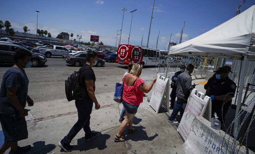 Many wait long periods of time to cross at San Ysidro Border