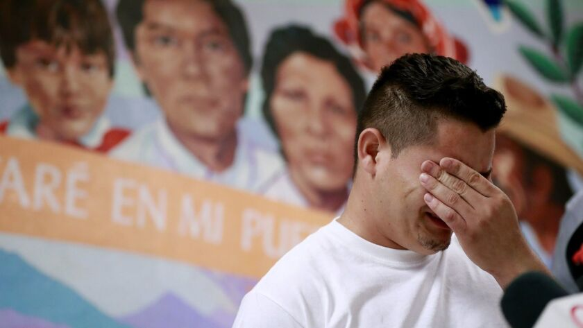 FILE - In this June 25, 2018 file photo, Christian, from Honduras, recounts his separation from his