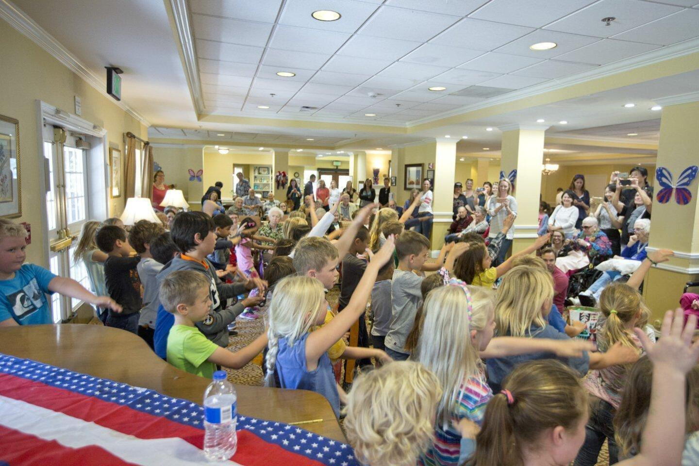 """First grade students from Del Mar Heights School perform """"Go Fish"""" for the residents of Brookdale senior living community in Carmel Valley"""