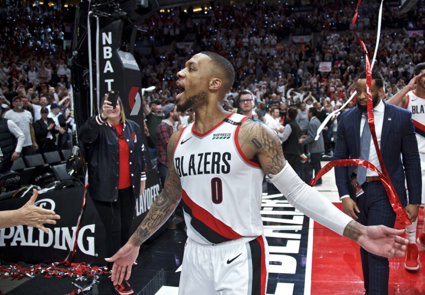 Trail Blazers guard Damian Lillard celebrates after making the game-winning shot to eliminate the Thunder in Game 5 of their playoff series on April 23.