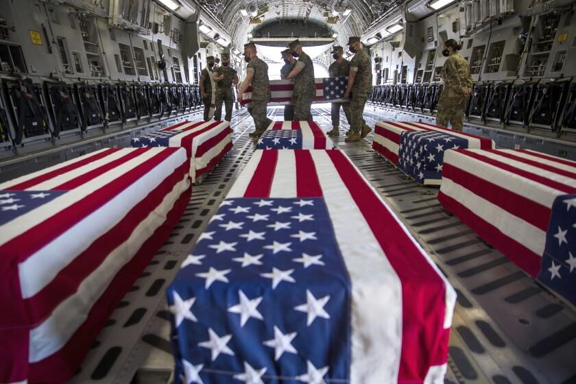 U.S. Marines and sailors carry a casket in Miramar, Calif.