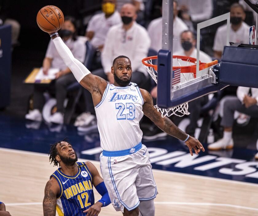 Lakers forward LeBron James elevates for a slam dunk.