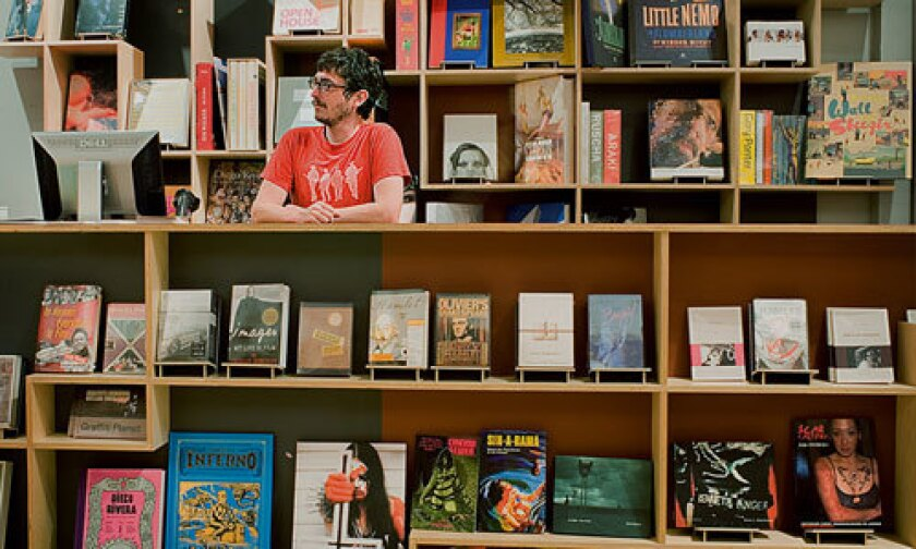 A clerk waits behind the counter at independent bookstore Skylight Books (1818 N. Vermont Ave.), which recently expanded into the space next door.