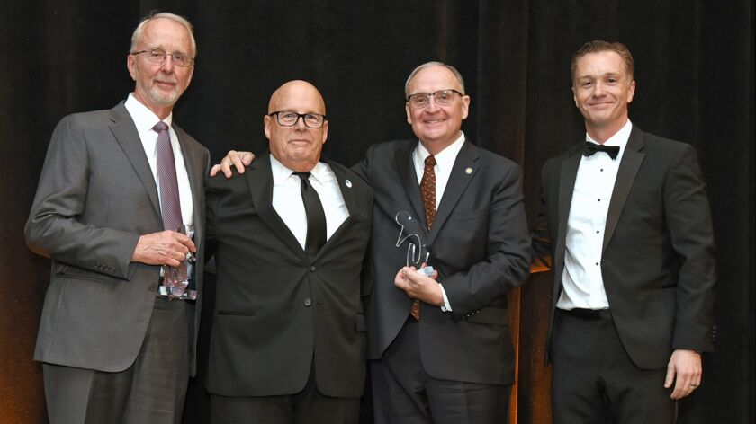 Honorees Keith Swayne, Steve O'Leary and Bill Edwards with Dr. Joshua Grill at Alzheimer's fundrais