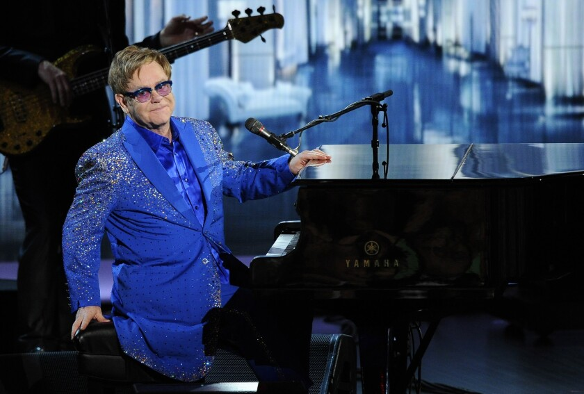 """Elton John performs """"Home Again"""" at the 65th Primetime Emmy Awards at the Nokia Theatre."""