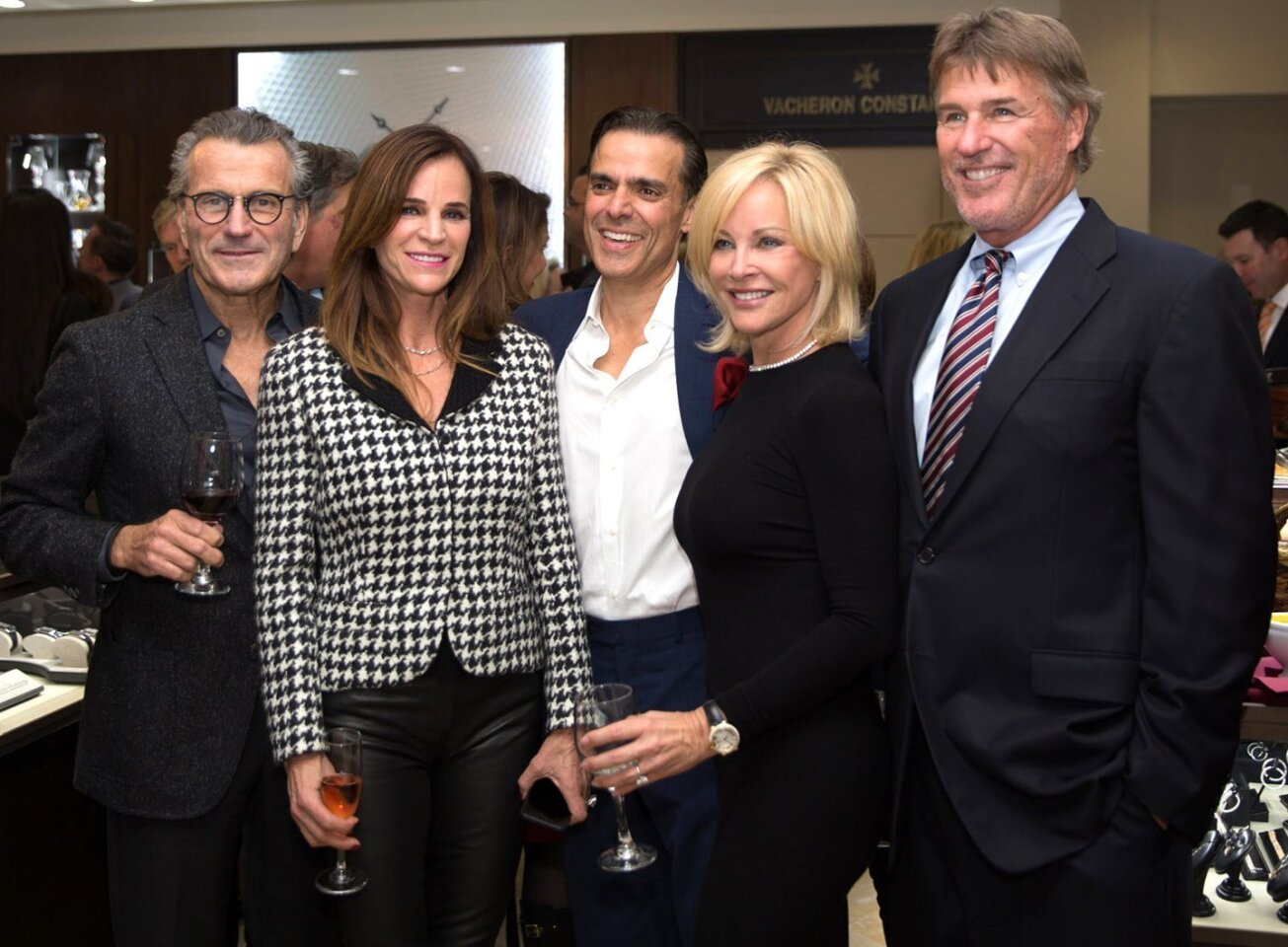 CJ Charles Jewelers president Vahid Moradi (center) with guests attend CJ Charles Jewelers' Holiday Party, Dec. 10, 2015 in La Jolla.